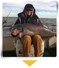 Woman Holding a Catfish